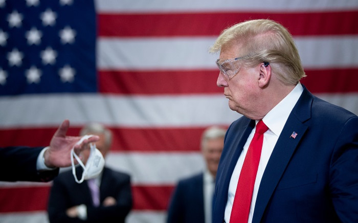 FILE: President Donald Trump, with an eye on his re-election prospects in November, has pressed for a further reopening of the United States as job losses mount from coronavirus shutdowns. Picture: AFP