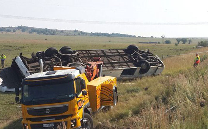 FILE: The overturned bus from the accident in which 10 people died in the Free State. Picture: Twitter @Netcare911_sa.