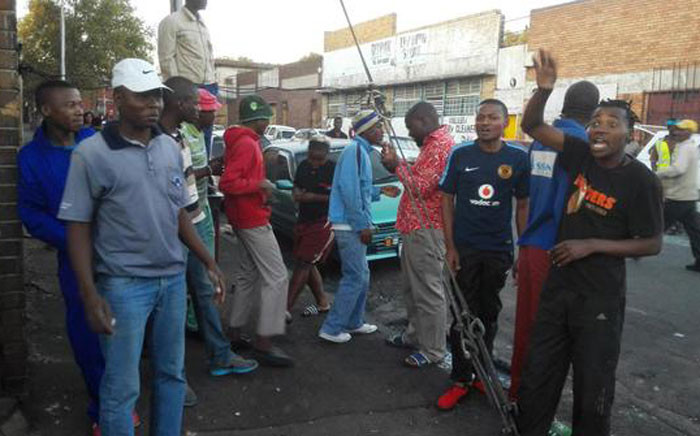 FILE: These residents from a hostel in Jeppestown say they want all foreigners gone. Picture: Mia Lindeque/EWN.