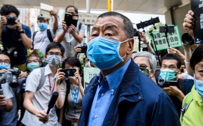 , Hong Kong media tycoon and founder of the Apple Daily newspaper Jimmy Lai (C) arrives at the West Kowloon Magistrates Court for charges related to last year's protests in Hong Kong. Picture: AFP
