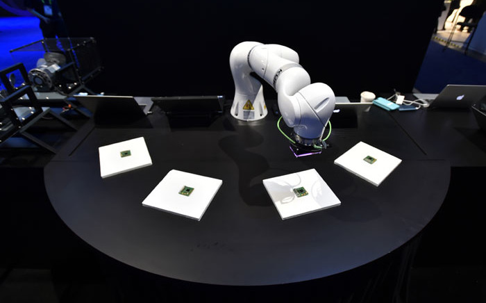 A robotic arm is used to demonstrate artificial intelligence in manufacturing at the IBM booth at CES 2019 at the Las Vegas Convention Center on 8 January 2019 in Las Vegas, Nevada. Picture: AFP