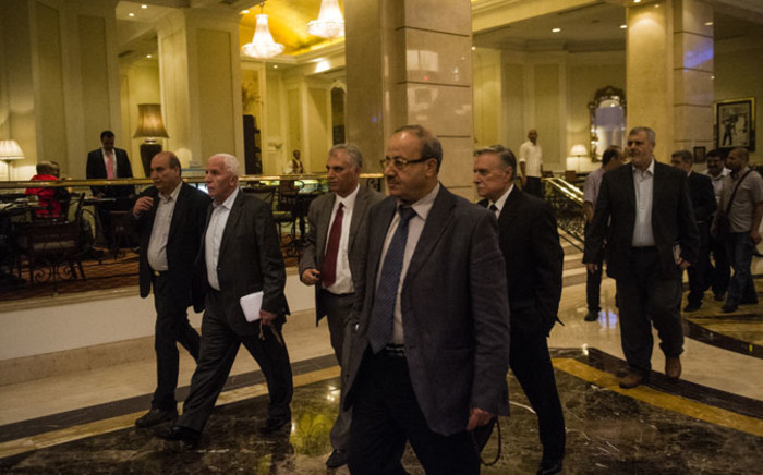 FILE: Head of the Palestinian delegation Azzam al-Ahmed (2L) and others members of the delegation arrive to the hotel after a meeting with Egyptians seniors intelligence in Cairo 11 August , 2014. Picture: AFP