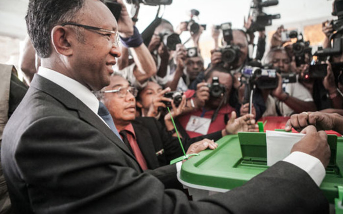 Presidential candidate Hery Rajaonarimampianina casts his ballot in a polling station during the presidential election on December 20, 2013 in Antananarivo, Madagascar. Picture: AFP.