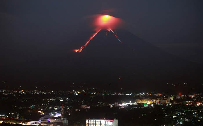 Lava from Mayon volcano is seen as it erupts in Legazpi on 15 January 2018. Picture: AFP