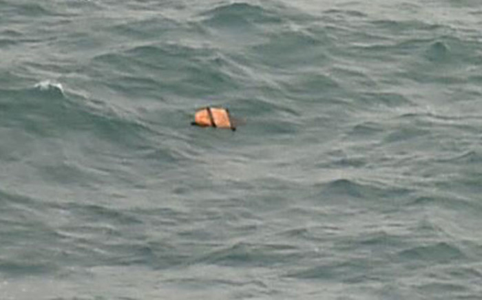 Photo taken from an Indonesian aircraft over the Java Sea shows possible plane debris from the missing AirAsia flight. Picture: AFP.
