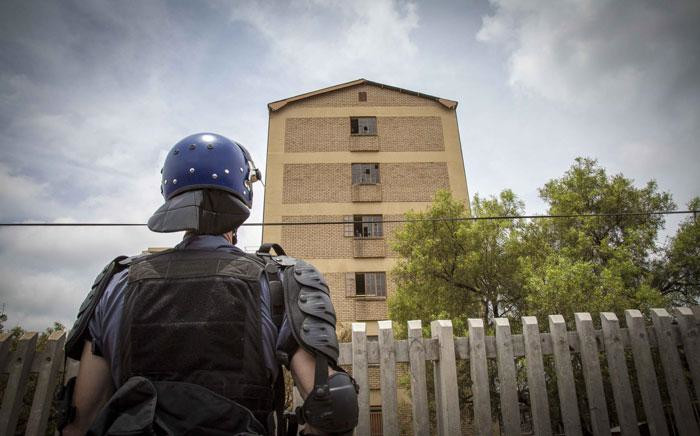 A security guard in riot gear watches a residence at the Tshwane University of Technology's Shoshanguve campus. Picture: Thomas Holder/EWN