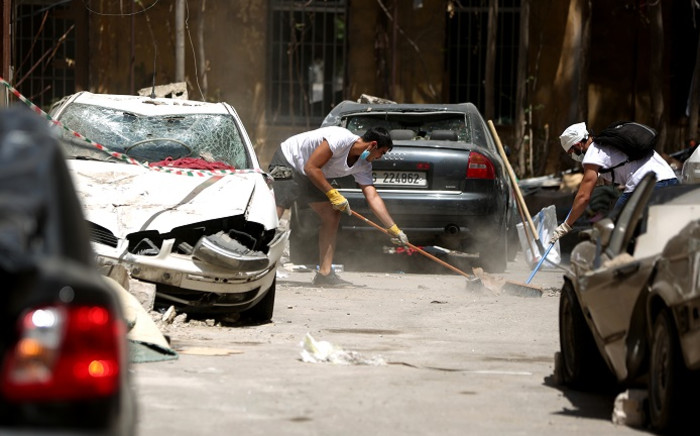 FILE: Volunteer clear the rubble in the Beirut neighbourhood of Mar Mikhael on 14 August 2020, more than a week after a massive blast ravaged the port and parts of the Lebanese capital. Picture: AFP