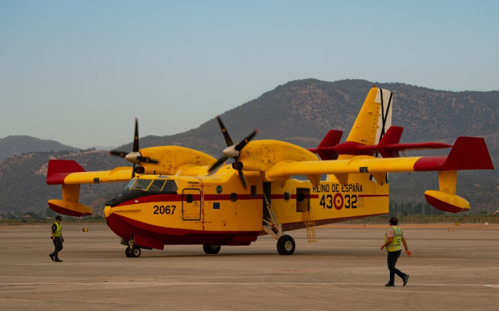 Staff members of the Spanish hydroplanes prepare for flights over the wildfires at the Dalaman Airport of Mugla on 3 August 2021. Turkey's struggle against its deadliest wildfires in decades come as a blistering heatwave grips southeastern Europe creating tinderbox conditions that Greek officials blame squarely on climate change. Picture: AFP