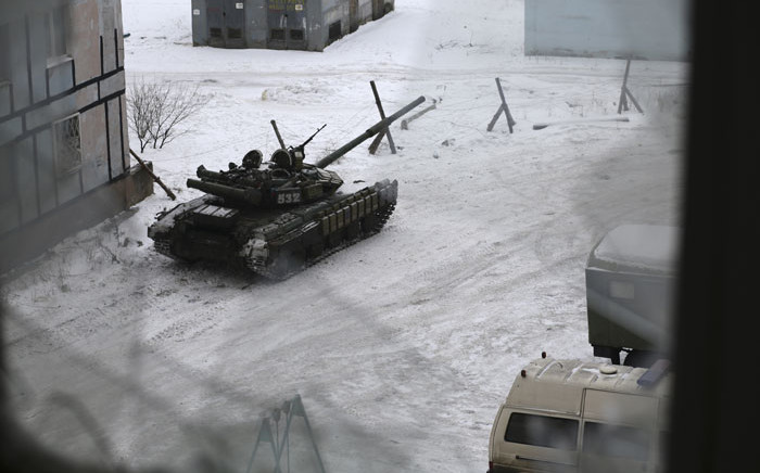 A tank from the Ukrainian Forces is stationed outside a building in the flashpoint eastern town of Avdiivka that sits just north of the pro-Russian rebels' de facto capital of Donetsk on February 2, 2017. Picture: AFP