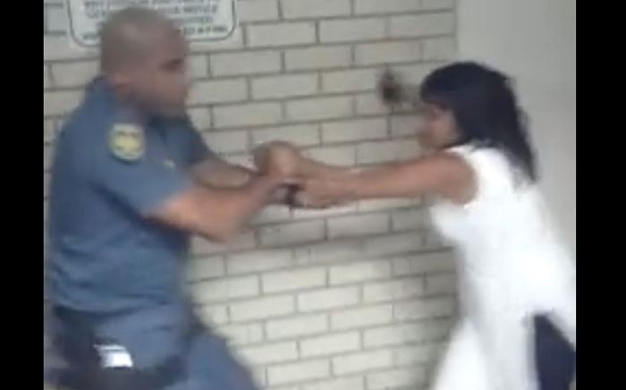 A screengrab of video footage posted to social media following claims that an officer manhandled a woman in front of her nine-year-old son. Picture: Facebook.com