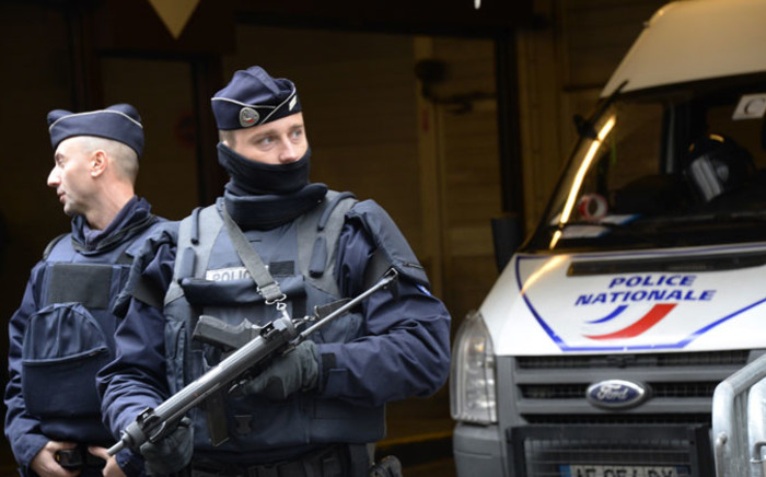 FILE: French police officers stand guard in front of the headquarters of French newspaper 'Liberation', on 9 January 2015 in Paris, after a deadly attack that occurred on 7 January by armed gunmen on the Paris offices of 'Charlie Hebdo'. Picture: AFP.