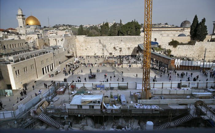 A picture taken on 1 March 2018 shows a general view of construction work in the Western Wall plaza of Jerusalem's Old City with the Dome of the Rock mosque in the al-Aqsa compound in the background. Picture: AFP.