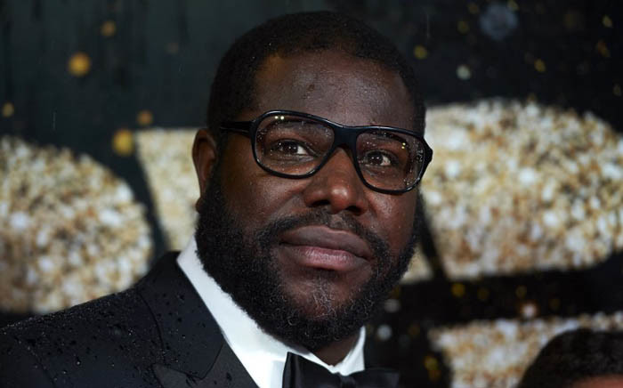 FILE: British director Steve McQueen poses for photographers on the red carpet as he arrives for the BFI London Film Festival Awards in central London on 15 October 2016. Picture: AFP