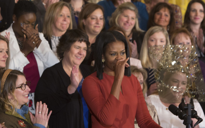 Michelle Obama pause to control her emotions as she gives her final remarks as US First Lady at the 2017 School Counselor of the Year event at the White House in Washington DC, 5 January, 2017. Picture: AFP.