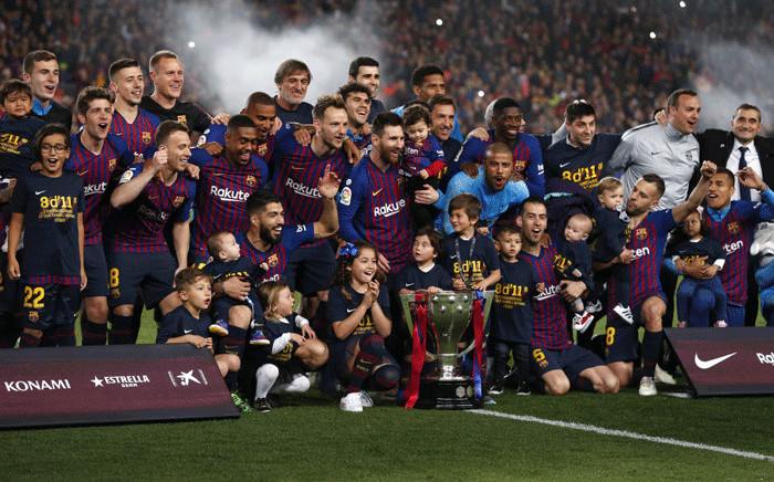 Barcelona's players celebrate with the Liga trophy after winning the club's 26th league title at the end of the Spanish League football match between Barcelona and Levante at the Camp Nou stadium in Barcelona on 27 April 2019. Picture: AFP.