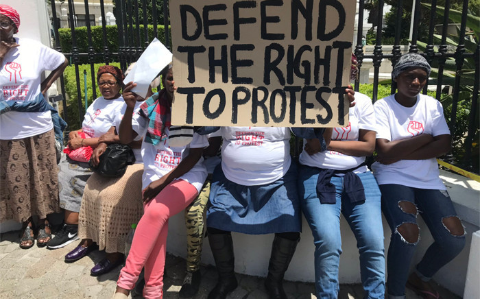 Scores of SJC members gathered outside Parliament on 19 November 2019 to affirm the #RightToProtest. Demonstrators said freedom of assembly and freedom of expression were still being restricted around the world. Picture: Lauren Isaacs/EWN.