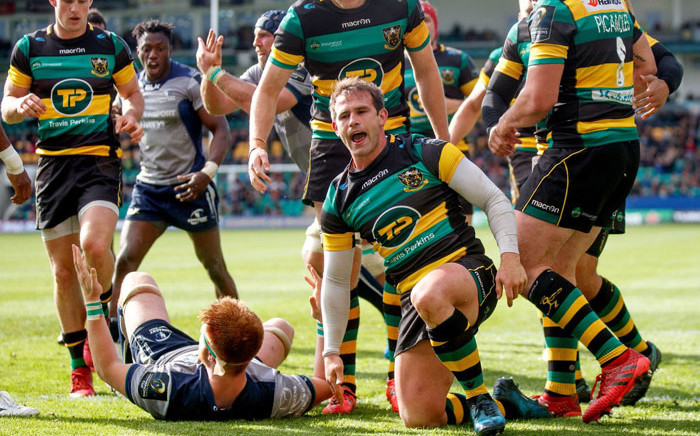 Nicholas Groom (centre) during his time with Northampton Saints. Picture: @SaintsRugby/Twitter