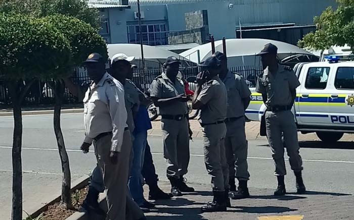 Home Affairs' immigration officials are seen outside ANN7 offices in Midrand, Johannesburg. Picture: Pelani Phakgadi/EWN.