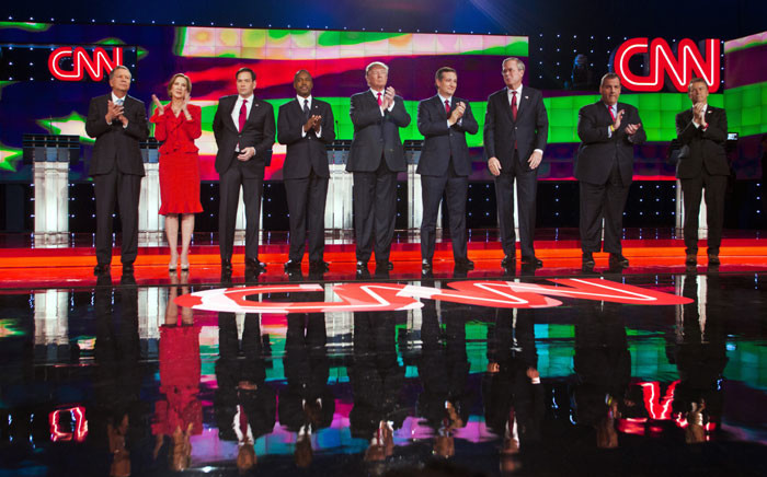 Republican presidential candidates (L-R) Ohio Governor John Kasich, businesswoman Carly Fiorina, Florida Sen. Marco Rubio, retired neurosurgeon Ben Carson, businessman Donald Trump, Texas Sen. Ted Cruz, former Florida Gov. Jeb Bush, New Jersey Gov. Chris Christie and Kentucky Sen. Rand Paul take the stage at the start of the Republican Presidential Debate, hosted by CNN, at The Venetian Las Vegas on December 15, 2015 in Las Vegas. Picture: AFP