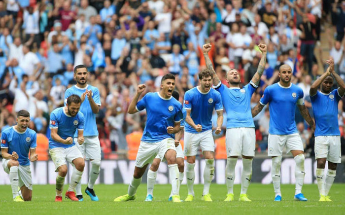 FILE: Manchester City players celebrate a successful penalty kick in the shootout with Liverpool during their Community Shield match at Wembley Stadium in London on 4 August 2019. Picture: @ManCity/Twitter