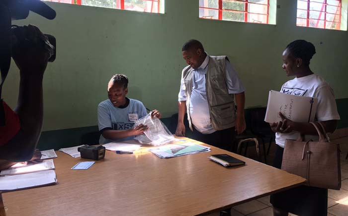IEC officials prepare to welcome eligible voters on the first day of the final weekend of registration. Picture: Katleho Sekhotho/EWN