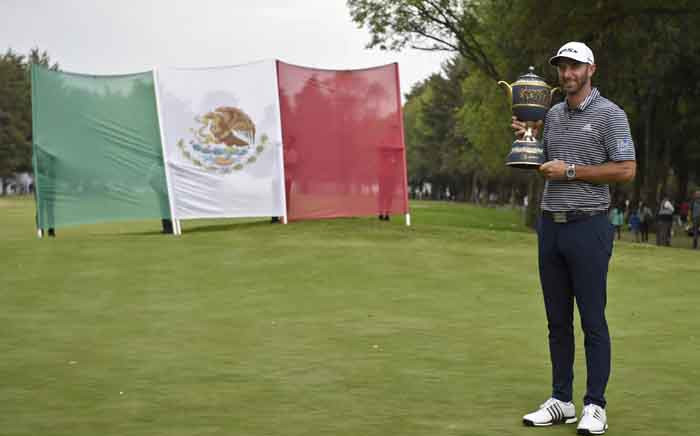 US golfer Dustin Johnson poses with the trophy after winning the World Golf Championship at Chapultepec's Golf Club in Mexico City on 24 February 2019. Picture: AFP