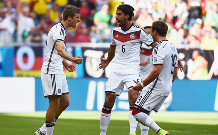 Germany's Thomas Muller celebrates with his team mates after scoring his third goal against Portugal during the opening match in their group of the 2014 Fifa World Cup in Brazil on 16 June 2014. Picture: Fifa.com.