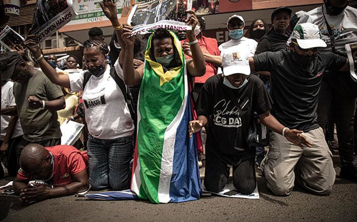 Members of the Enlightened Christian Gathering (ECG) came out in support of self-proclaimed prophet, Shepherd Bushiri, and his wife Mary Bushiri, who appeared at the Pretoria Magistrates Court on 21 October 2020 on fraud and money laundering charges. Picture: Xanderleigh Dookey/EWN