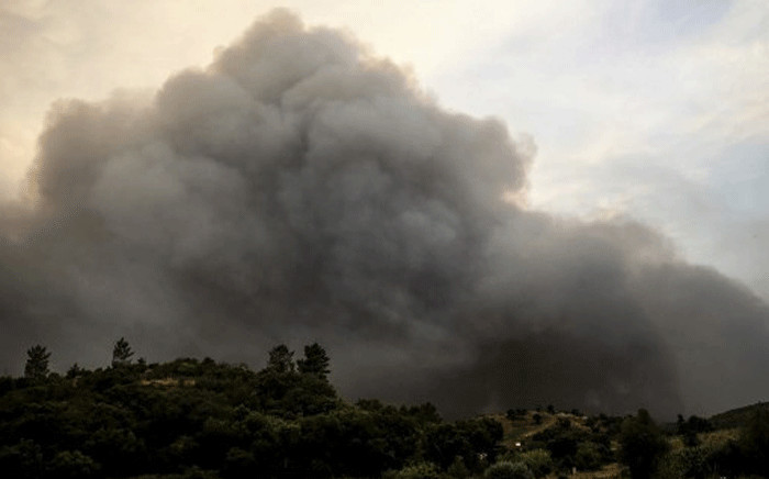 Smoke columns rise due to a wildfire close to Monchique in the Portuguese Algarve, on August 4, 2018. Picture: AFP.