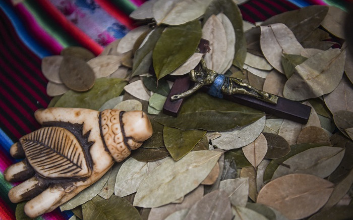 Religious items and coca leaves to be used for a ritual of predictions at the Wishes Market in Lima, are seen on December 30, 2020. Picture: Ernesto Benavides / AFP.