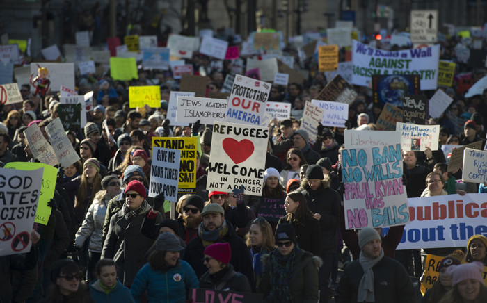 Protesters march on Pennsylvania Avenue while protesting against US President Donald Trump's recent action on refugees entering the US on 4 February, 2017, in Washington, DC. Picture: AFP.