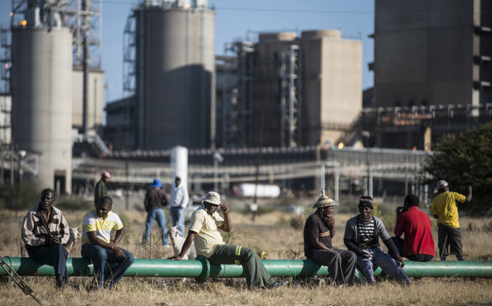 FILE: Striking platinum miners gather at the Wonderkop Stadium in Marikana. Picture: AFP.