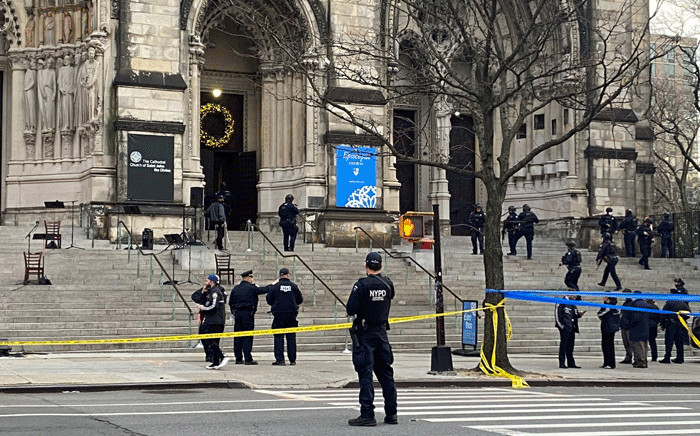 Police are seen outside of the Cathedral of St. John the Divine in New York on December 13, 2020, after a shooter opened fire outside the church before police returned fire and took the man into custody. Picture: AFP.