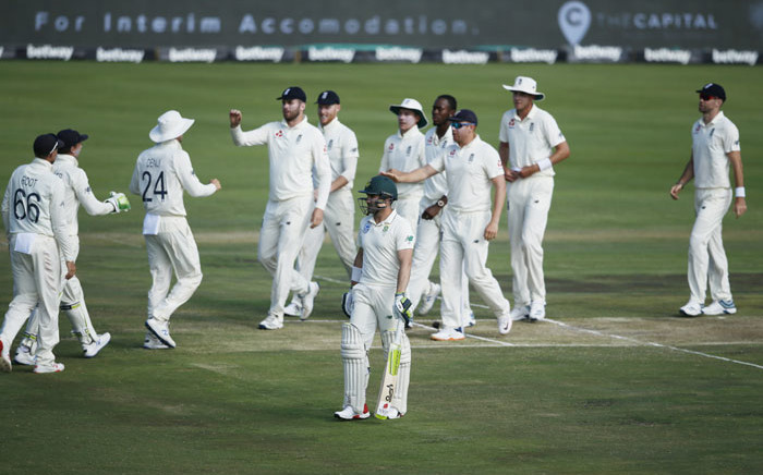 South Africa's Dean Elgar (front C) walks back to the pavilion after his dismissal by England's Jofra Archer during the second day of the first Test cricket match between South Africa and England at SuperSport Park Stadium at Centurion near Pretoria on 27 December 2019. Picture: AFP