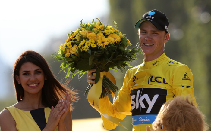 Tour de France 2016 winner Christopher Froome celebrates his overall leader yellow jersey on the podium on the Champs-Elysees avenue in Paris, at the end of the 113 km twenty-first and last stage of the 103rd edition of the Tour de France cycling race on 24 July, 2016 between Chantilly and Paris. Picture: AFP.