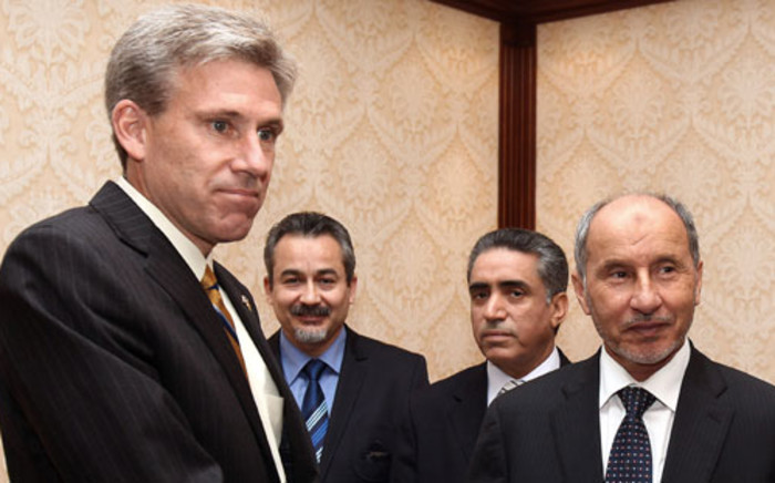 The late US Ambassador to Libya Christopher Stevens with Libyan President Mahmoud el-Megarif. Picture: AFP