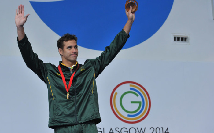 South Africa's Chad le Clos poses on the podium during the Men's 100m Butterfly medal ceremony at the Tollcross International Swimming Centre during the 2014 Commonwealth Games in Glasgow on 28 July, 2014. Picture: AFP.