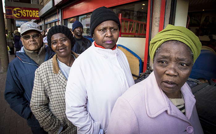 FILE: Pensioners queue outside of a supermarket in Mitchells Plain on the 1st of the month to collect their Sassa grants. Picture: Thomas Holder/EWN