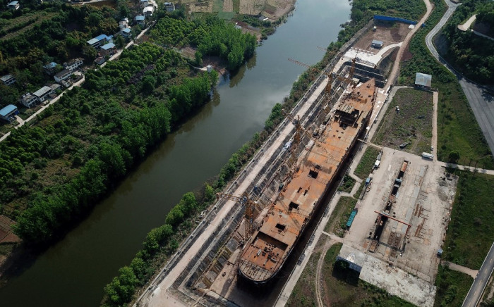 This aerial photo taken on 27 April 2021 shows a still-under-construction replica of the Titanic ship in Daying County in China's southwest Sichuan province. The ill-fated Titanic which sank over a hundred years ago is being resurrected as the centrepiece of a theme park in southwest China. Picture: AFP
