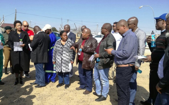 The Department of Water and Sanitation Free State regional head, Dr Ntili, addresses portfolio members on a sanitation project in Clocolan Setsoto Local Municipality, Free State. Picture: @DWS_RSA/Twitter
