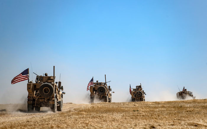 A US military convoy takes part in a joint patrol with Turkish troops in the Syrian village of al-Hashisha on the outskirts of Tal Abyad town along the border with Turkish troops, on 8 September 2019. Picture: AFP