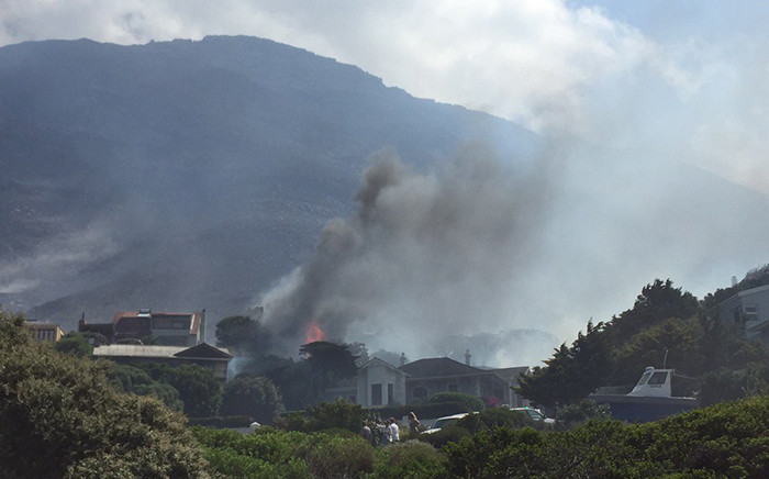 A house catches fire in Murdock Valley, Simons Town in Cape Town. Picture: Aletta Harrison/EWN