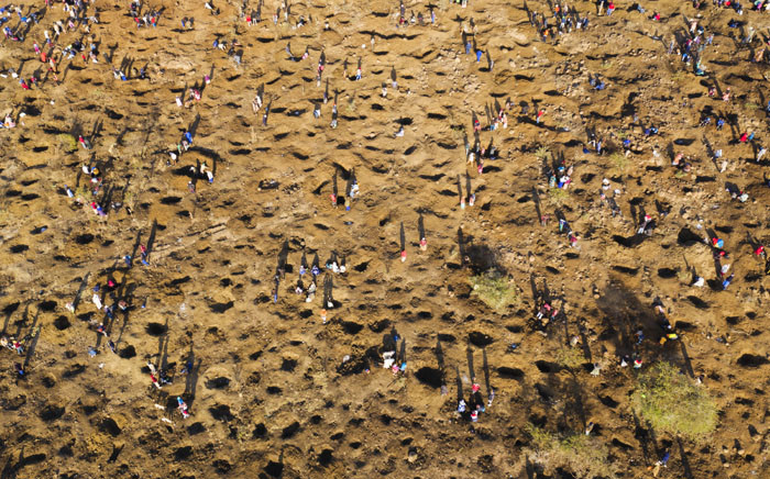 An aerial view shows people digging on 15 June 2021 as they search for what they believe to be diamonds after the recent discovery of unidentified stones at KwaHlathi village near Ladysmith in KwaZulu-Natal. Picture: Phill Magakoe/AFP
