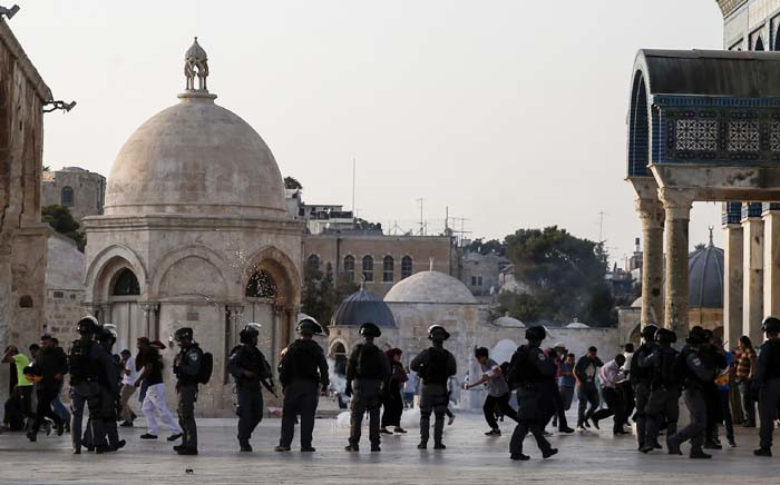 Israeli security forces fire tear gas to disperse Palestinians after clashes broke out inside Al-Aqsa mosque's compound in Jerusalem's Old City on 27 July 2017. Picture: AFP.