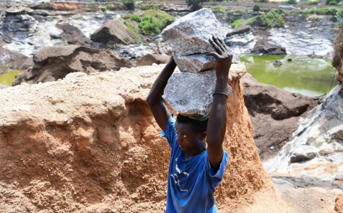 FILE: Children working at a mine site in Burkina Faso. Picture: UNICEF