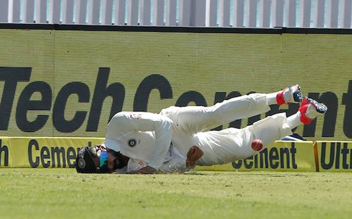 India captain Virat Kohli dives to stop a Peter Handscomb drive from reaching the boundary. Picture: Twitter/@BCCI.