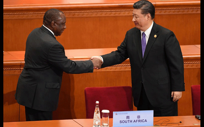FILE: President Cyril Ramaphosa (L) shakes hands with China's President Xi Jinping after his speech during the opening ceremony of the Forum on China-Africa Cooperation at the Great Hall of the People in Beijing on 3 September 2018. Picture: AFP