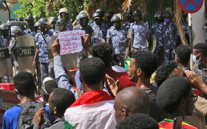 Sudanese protesters shout slogans outside the Council of Ministers in the heart of Sudan's capital Khartoum on 17 August 2020. Picture: AFP