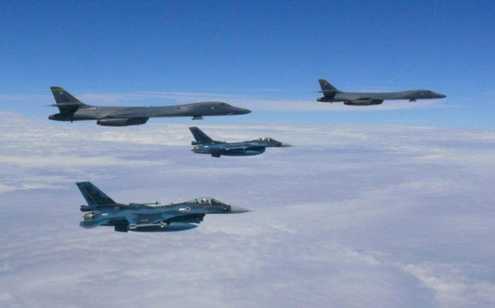 This image obtained from the US Air Force shows two Air Force B-1B Lancers flying from Andersen Air Force Base, Guam, for a 10-hour mission, flying in the vicinity of Kyushu, Japan, the East China Sea, and the Korean peninsula. Picture: AFP.