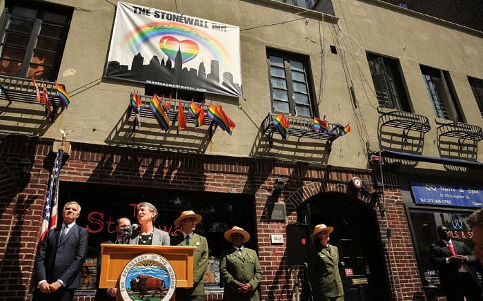 Secretary of the Interior Sally Jewell speaks to the media in front of The Stonewall Inn announcing a new National Park Service initiative intended to identify places and events associated with the civil rights struggle of lesbian, gay, bisexual, and transgender (LGBT) Americans on 30 May, 2014 in New York City. Picture: AFP.